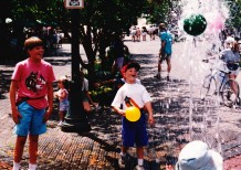Brandon & Chad playing in fountain in Aspen